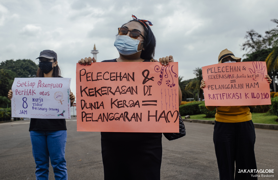 Participants demand the government pass a long-delayed Elimination of Sexual Violence bill during International Women