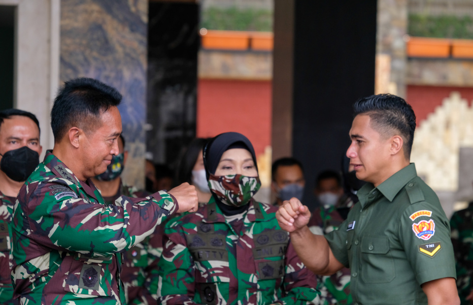 Aprilia Manganang, right, trades a fist bump with Army Chief of Staff General Andika Perkasa  at the Army headquarters in Central Jakarta on March 19, 2021. (BeritaSatu Photo/Ruht Semiono)
