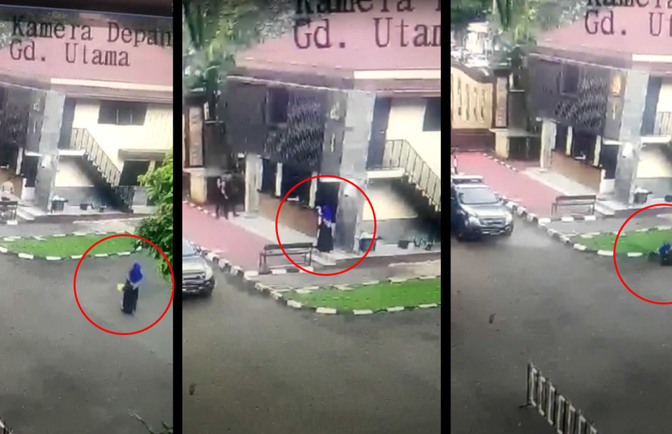 A person in female dress and niqab is shot to death after pointing a gun at the National Police headquarters in South Jakarta on March 31, 2021. (Videography)