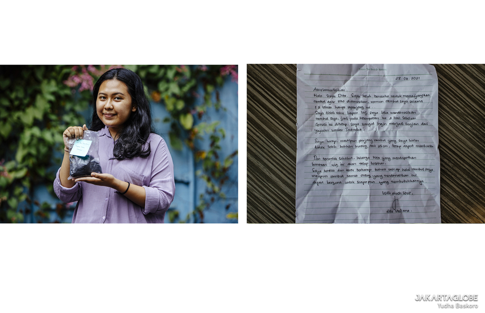 1. Ayu, 22, a hair donor carries her hair outside Prasetia Mulya University, in South Jakarta on March 30, 2021. (JG Photo/Yudha Baskoro)