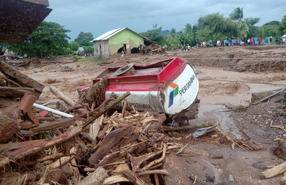 An oil tanker belonging to state owned oil company Pertamina is destroyed by a massive landslide on Adonara Island, East Nusa Tenggara province on April 4, 2021. (Antara Photo)
