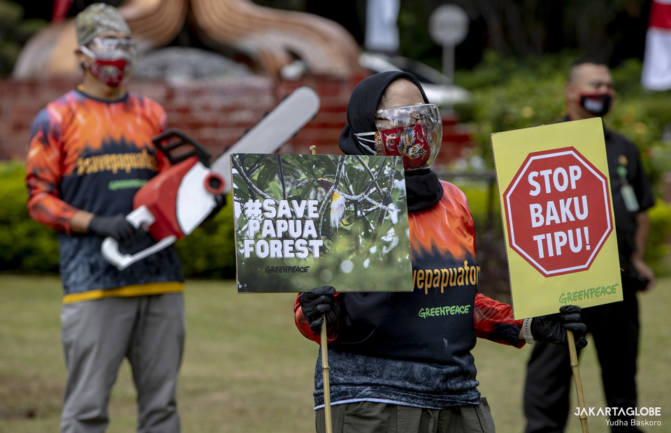 An activist carries poster during protest in front of the Environment and Forestry Ministry (KLHK) building in Central Jakarta on April 8, 2021. (JG Photo/Yudha Baskoro)