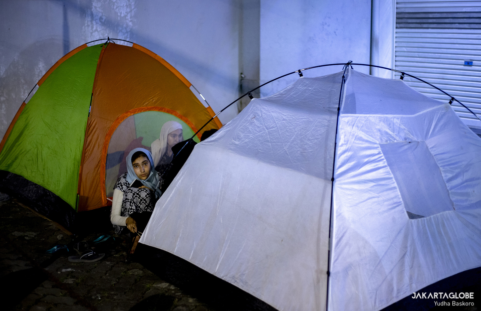 Refugees and asylum seekers stay in a makeshift tent outside the offices of the United Nations High Commissioner for Refugees (UNHCR) in Central Jakarta on April 27, 2021. (JG Photo/Yudha Baskoro)