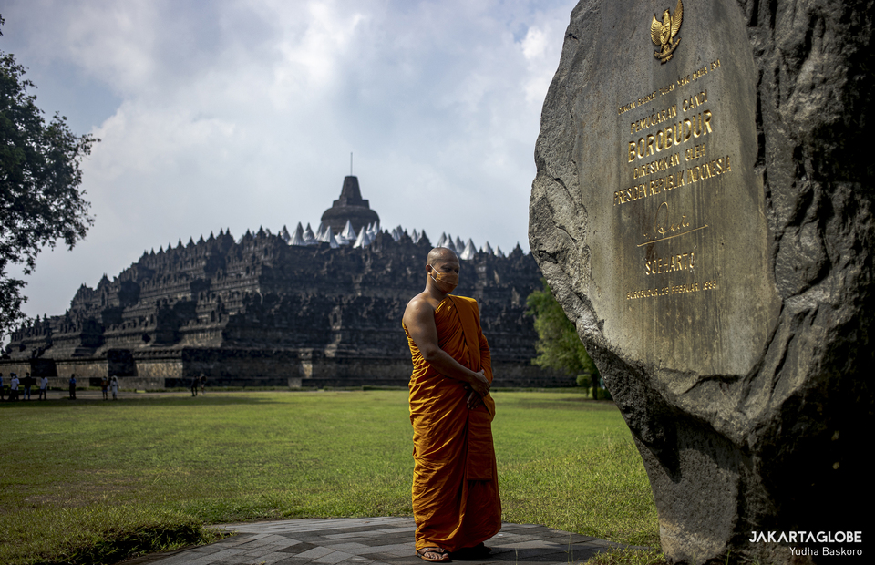 Buddhist monk stands in front of Borobudur Temple after pradakshina ritual at the Borobudur Temple in Central Java, on May 26, 2021. (JG Photo/Yudha Baskoro)