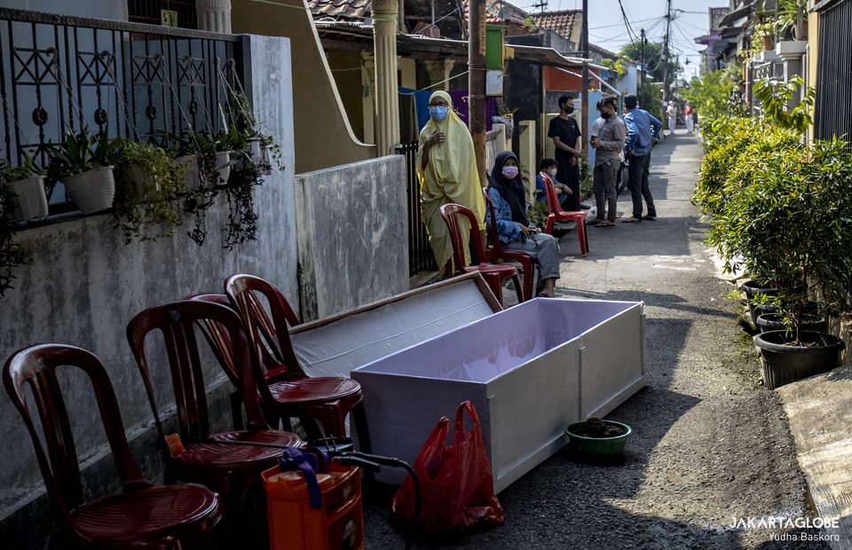 A coffin is seen outside home of the deceased in Bogor, West Java on July 16, 2021. (JG Photo/Yudha Baskoro)
