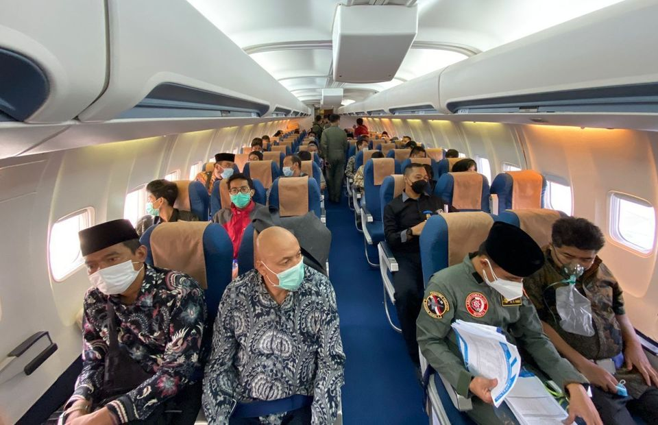 Indonesian evacuees from Kabul, Afghanistan, are seen onboard an Air Force plane on August 20, 2021. (Photo Courtesy of the Foreign Affairs Ministry)