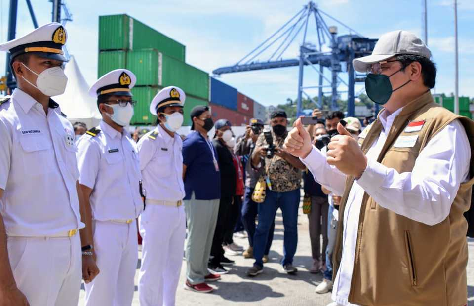 Coordinating Minister for the Economy Airlangga Hartarto, right, greets crew members of MV Tidar at Jayaoura Port, Papua on September 4, 2021. The ferry is converted into as a makeshift isolation facility for Covid-19 patients in the provincial capital.