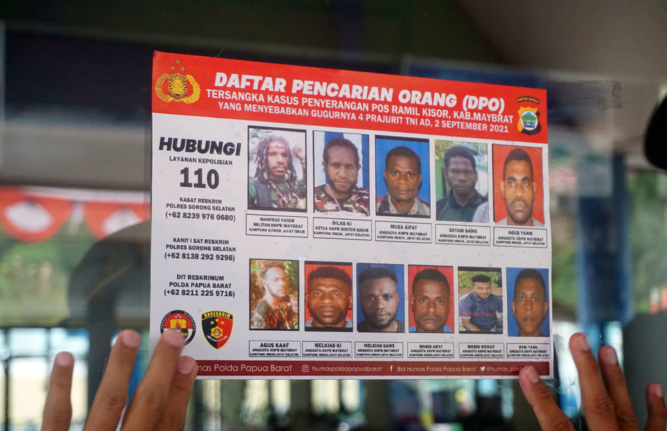 The Indonesian police release the photographs of 11 native Papuans at a Sorong Port gate in West Papua on Sept. 16, 2021. The individuals are wanted for allegedly killing four army soldiers in the Sept. 2 attack on a military post in Maybrat district. (Antara Photo/Olha Mulalinda)