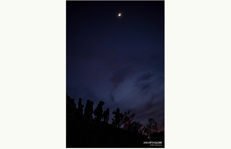 A crescent is seen at Sikunir Hill at Dieng Plateu in Central Java on October 2, 2021. (JG Photo/Yudha Baskoro)